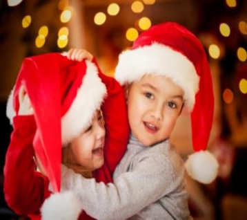 little kids wearing Santa hats